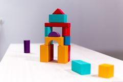 Bright colorful wooden blocks toy. Bricks children building tower, castle. Red, orange and blue. Bright colorful wooden blocks toy. Bricks children building royalty free stock photo