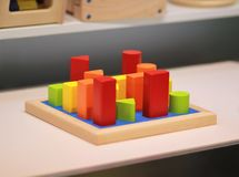 Bright colorful wooden children toy sorter on a shelf in the shop. Toy shopping stock photo