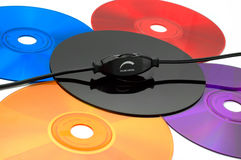 Bright colors of music. Volume control knob on colorful cd (dvd) discs Royalty Free Stock Photo