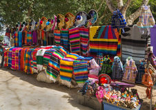 Bright colors of national mexican souvenirs. Mexicans sell productions of the local handicrafts Stock Image