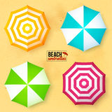 Bright colors umbrellas set on sandy beach seamless background Royalty Free Stock Photo