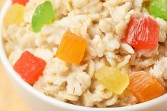 Bright colors. Useful breakfast. Oatmeal with dried fruits. Healthy food Stock Photography