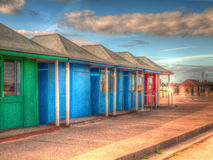 Bright coloured beach huts HDR Stock Images