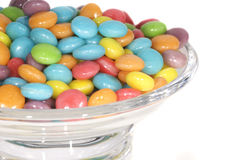 Bright coloured candy sweets in a bowl. Bright coloured candy sweets in a glass bowl royalty free stock photography