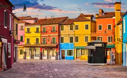 Bright coloured houses on Burano island Venice Italy with blue sky and clouds. Royalty Free Stock Image