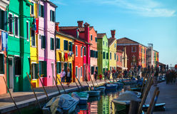 Bright coloured houses on coast of channel in Burano island Royalty Free Stock Images