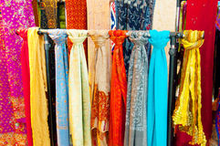 Bright Coloured Scarves. A row of brightly coloured scarves Royalty Free Stock Images