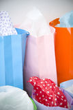 Bright coloured shopping bags with gift wrap. Array of bright coloured shopping bags with gift wrap Royalty Free Stock Photography