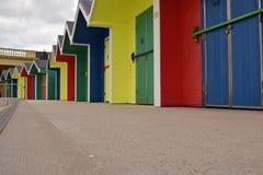 So bright so colourful. Beach huts brighten up a dull day stock photo