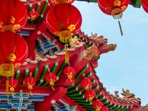 Red Lantern decoration details on a Chinese Temple roof against a blue sky stock images