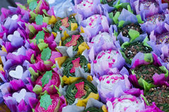 Bright colourful cupcakes in rows Stock Photo