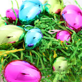 Bright colourful Easter eggs on straw Stock Images