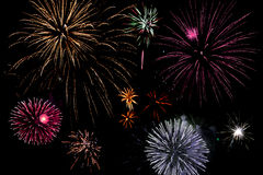 Bright and colourful fireworks. Assorted bright and colourful fireworks exploding in the sky stock image