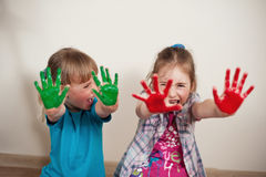 Bright colours. Screaming girls with painted hands Royalty Free Stock Image