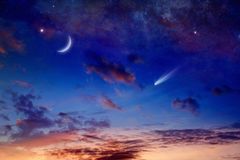 Bright comet, falling star and crescent in glowing sunset sky. Astronomical scientific background - bright comet, falling star and crescent in glowing sunset sky royalty free stock photos