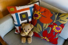 Bright, comfy throw pillow designs with bold orange accents