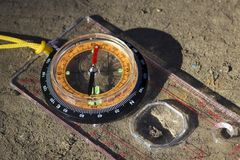 Bright compass with orange dial close up. Bright compass with orange dial closeup necessary device for determining the correct direction Royalty Free Stock Photos