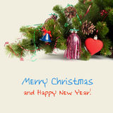 Bright composition with christmas tree, red toy heart and blue bell (with easy removable sample text). Royalty Free Stock Images