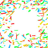 Bright confetti dust explosion over white background Royalty Free Stock Images