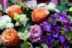 Bright contrasting bouquet assembled from hydrangea, peony rose, chrysanthemum, eustoma and alstroemeria close-up stock photos