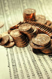 Bright copper coins. Stacked on a page of stock index figures Stock Photos