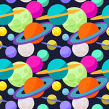 Bright cosmic seamless pattern background with funny cartoon planets in open space Royalty Free Stock Image