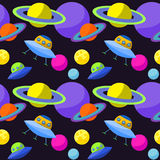Bright cosmic seamless pattern background with funny cartoon ufo and planets in open space Royalty Free Stock Image