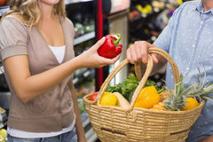 Bright couple buying differents vegetables Stock Photo