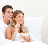 Bright couple having breakfast Royalty Free Stock Photography