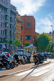 Bright cozy street filled with cars and bikes in Nice, Azure coa Royalty Free Stock Images