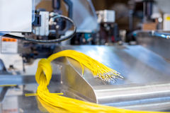 Bright crimped wires on machine, close-up Stock Image
