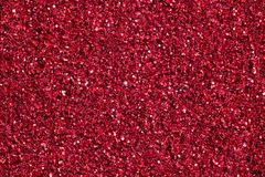 Bright crimson background with glitter. Red glitter texture. stock photography