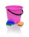 Bright crimson bucket, blue brush and orange sponge Royalty Free Stock Photos