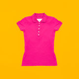 Bright crimson polo shirt on yellow background. Stock Photography