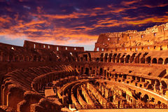 Bright crimson sunset over the ancient Colosseum during a sunset. Rome. Italy Royalty Free Stock Images
