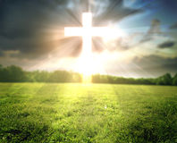 Bright cross in field. A bright glowing cross over a grassy field stock photos