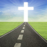 Bright Cross on the road Stock Photo