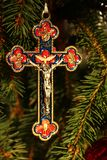 Bright crucifix hanging on green pine tree royalty free stock photos