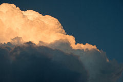 BRIGHT CUMULUS CLOUD AT SUNSET stock photography