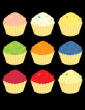 Bright cupcake variations. Frosted cupcake in nine bright variations isolated on a black background royalty free illustration