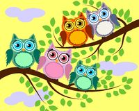 Bright cute cartoon owls sit on the flowering branches of fantastic trees. Bright cute cartoon owls sit on the branches of fantastic trees royalty free illustration