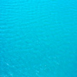 Bright cyan blue  sea water may use as background or texture. Stock Image