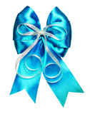 Bright cyan bow with silver ribbon made from silk Stock Photo