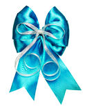 Bright cyan bow with silver ribbon made from silk Royalty Free Stock Photos