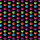 Bright 3D pink purple blue and green polka dots in a repeating pattern. Bright polka dots with 3D appearance in purple, red, blue and green for gift wrapping Stock Photo