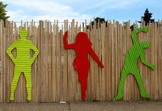 Bright dancing silhouettes on the temporary fence near Next Gallery on Colfax Avenue in Denver. Denver, Colorado - August 25, 2018: Bright dancing silhouettes on royalty free stock photo