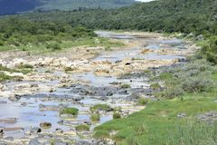 Rocky River Bed. Bright and dark rocks, both in one river bed Stock Photos