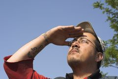 Bright Day. Bluecollar worker shadding his eyes from the sun royalty free stock photo