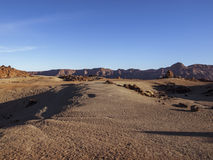 Bright day in the desert (Tenerife, Canary Island). Volcanic landscape - stone - sand - hills - blue sky - sunny Royalty Free Stock Images