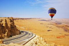 The bright decorative balloon soars above road Stock Photography